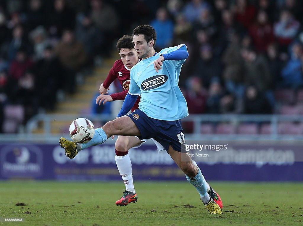 Luke Howell of Dagenham & Redbridge attempts to control the ball watched by Lewis Hornby of Northampton Town during the npower League Two match between Northampton Town and Dagenham & Redbridge at Sixfields Stadium on January 1, 2013 in Northampton, England.