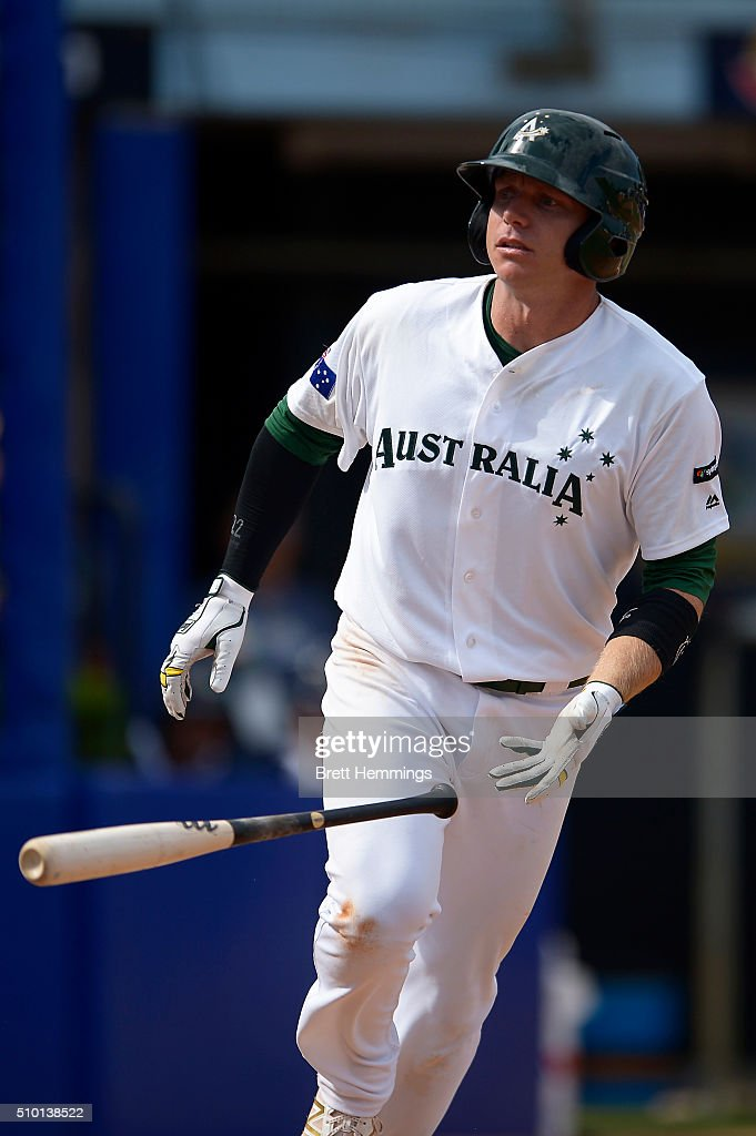 Luke Hughes of Australia is walked to first base during the World baseball Classic Final match between Australia and South Africa at Blacktown International Sportspark on February 14, 2016 in Sydney, Australia.