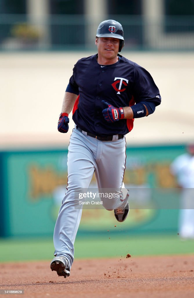 Luke Hughes #38 of the Minnesota Twins rounds second base after hitting a home run in the first inning during a game against the St. Louis Cardinals at Roger Dean Stadium on March 25, 2012 in Jupiter, Florida.