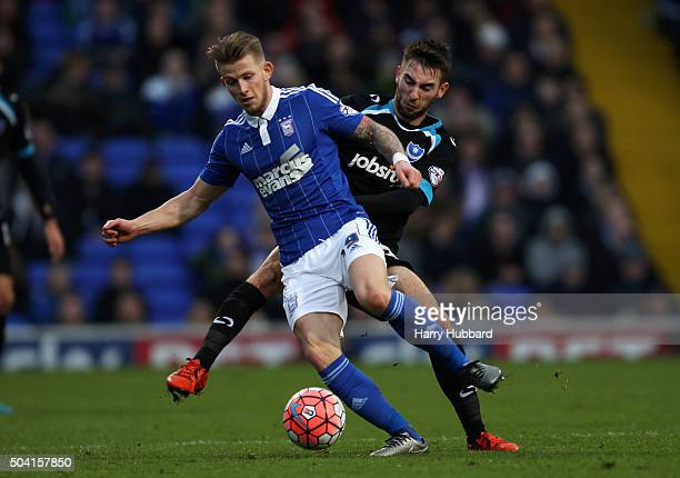 Luke Hyam of Ipswich and Ben Close of Portsmouth in action during the Emirates FA Cup Third Round match between Ipswich Town and Portsmouth at...