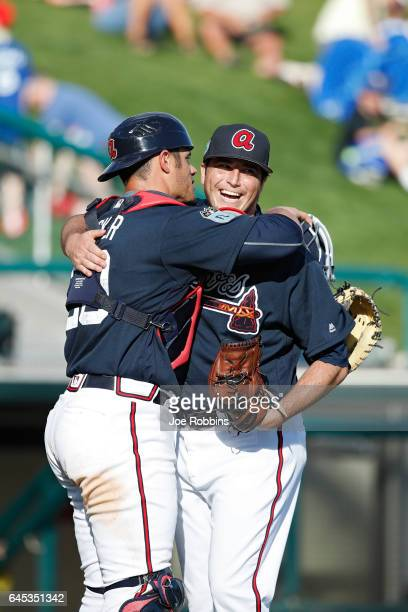 Luke Jackson and Anthony Recker of the Atlanta Braves celebrate after the spring training game against the Toronto Blue Jays at Champion Stadium on...