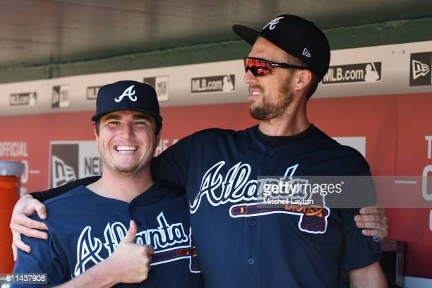 Luke Jackson of the Atlanta Braves and Lane Adams pose before a baseball game against the Washington Nationals at Nationals Park on July 9 2017 in...