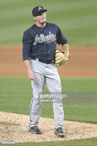 Luke Jackson of the Atlanta Braves reacts to a pitch during a baseball game against the Washington Nationals at Nationals Park on June 13 2017 in...