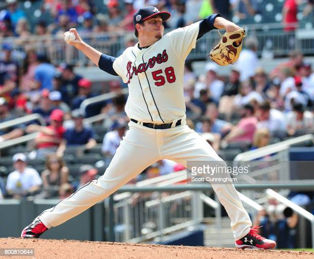 Luke Jackson of the Atlanta Braves throws a seventh inning pitch against the Milwaukee Brewers at SunTrust Park on June 25 2017 in Atlanta Georgia