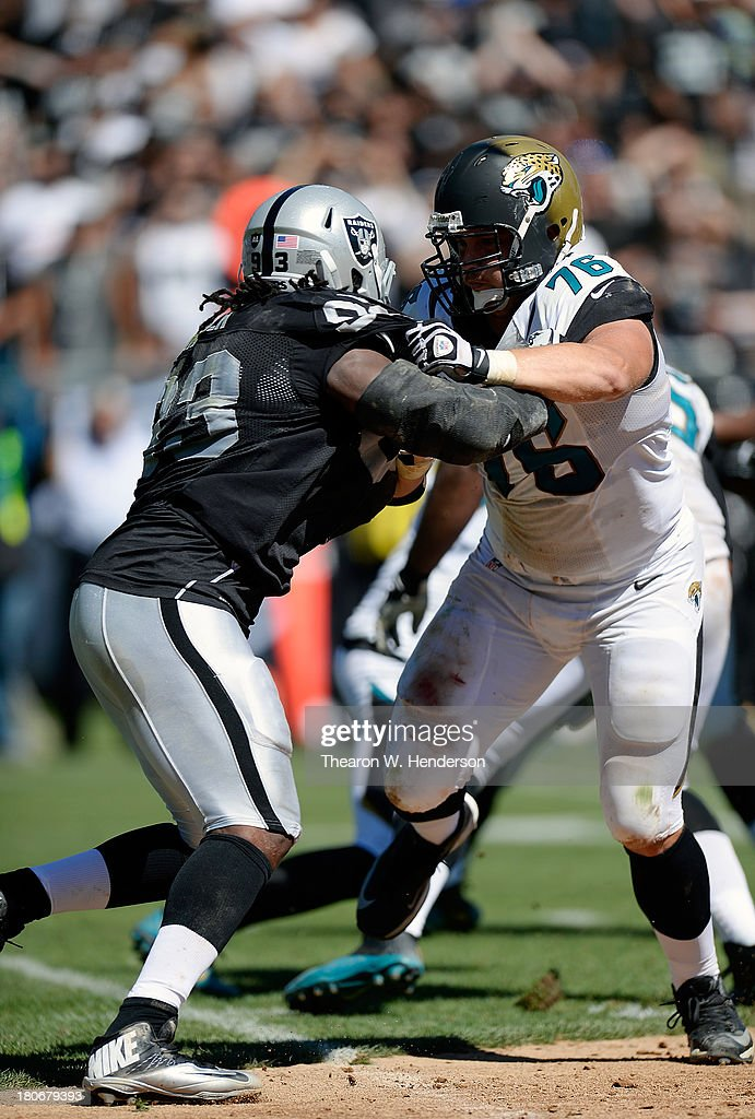 <a gi-track='captionPersonalityLinkClicked' href=/galleries/search?phrase=Luke+Joeckel&family=editorial&specificpeople=7415529 ng-click='$event.stopPropagation()'>Luke Joeckel</a> #76 of the Jacksonville Jaguars blocks Jason Hunter #93 of the Oakland Raiders during the second quarter at O.co Coliseum on September 15, 2013 in Oakland, California.