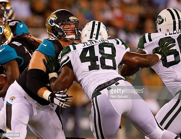 Luke Joeckel of the Jacksonville Jaguars blocks Jordan Jenkins of the New York Jets in an NFL preseason game at MetLife Stadium on August 11 2016 in...