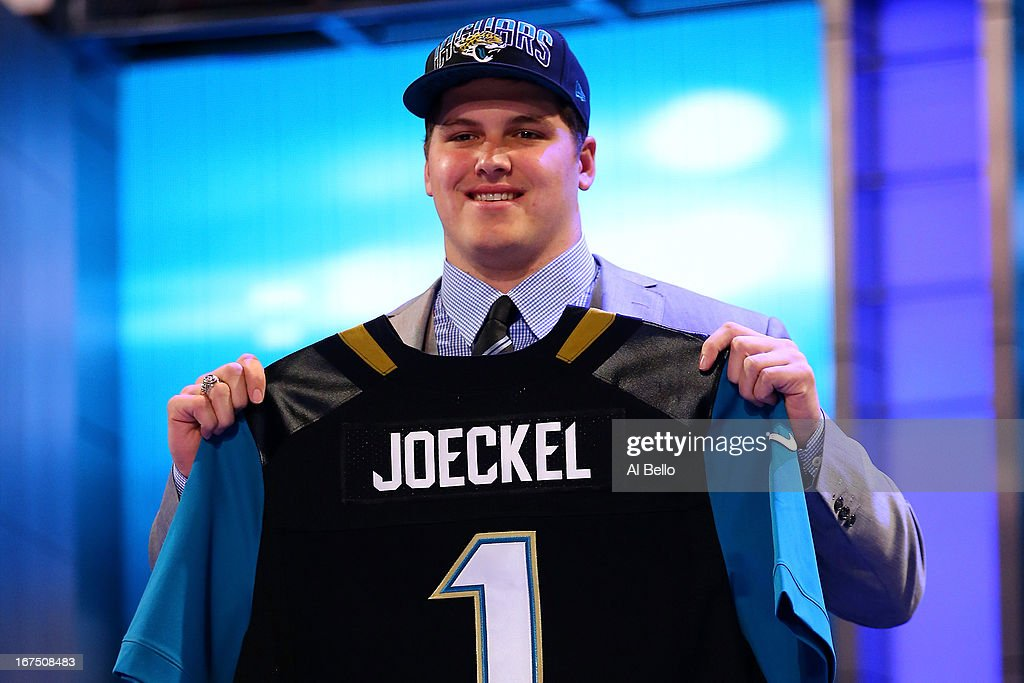 <a gi-track='captionPersonalityLinkClicked' href=/galleries/search?phrase=Luke+Joeckel&family=editorial&specificpeople=7415529 ng-click='$event.stopPropagation()'>Luke Joeckel</a> of the Texas A&M Aggies holds up a jersey on stage after he was picked #2 overall by the Jacksonville Jaguars in the first round of the 2013 NFL Draft at Radio City Music Hall on April 25, 2013 in New York City.
