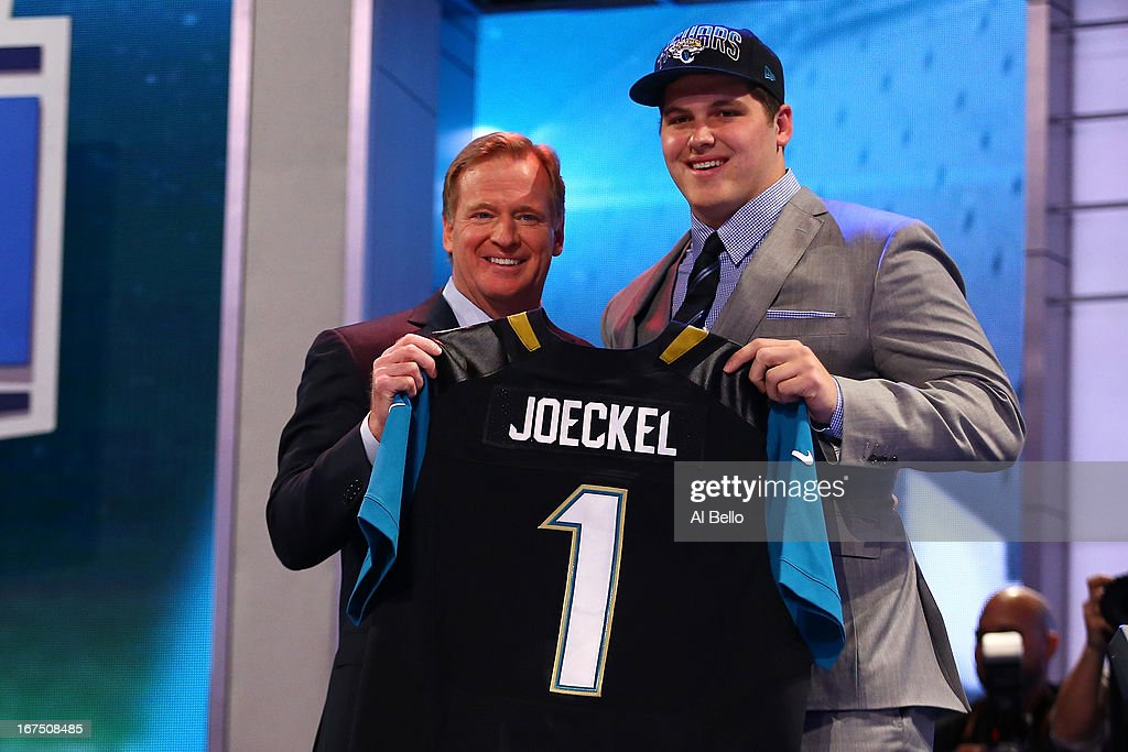 <a gi-track='captionPersonalityLinkClicked' href=/galleries/search?phrase=Luke+Joeckel&family=editorial&specificpeople=7415529 ng-click='$event.stopPropagation()'>Luke Joeckel</a> (R) of the Texas A&M Aggies stands with NFL Commissioner <a gi-track='captionPersonalityLinkClicked' href=/galleries/search?phrase=Roger+Goodell&family=editorial&specificpeople=744758 ng-click='$event.stopPropagation()'>Roger Goodell</a> as they hold up a jersey on stage after Joeckel was picked #2 overall by the Jacksonville Jaguars in the first round of the 2013 NFL Draft at Radio City Music Hall on April 25, 2013 in New York City.