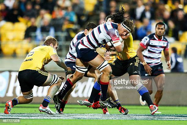 Luke Jones of the Rebels is tackled by Ma'a Nonu of the Hurricanes during the round seven Super Rugby match between the Hurricanes and the Rebels at...