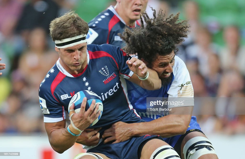Luke Jones of the Rebels is tackled during the round one Super Rugby match between the Rebels and the Force at AAMI Park on February 15, 2013 in Melbourne, Australia.