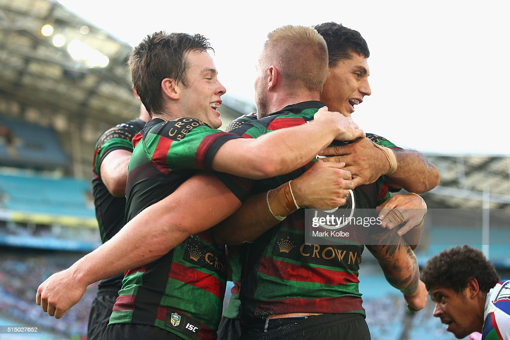 Luke Keary (L) and Kyle Turner (R) congratulate Aaron Gray (C)of the Rabbitohs after he scored a try during the round two NRL match between the South Sydney Rabbitohs and the Newcastle Knights at ANZ Stadium on March 12, 2016 in Sydney, Australia.