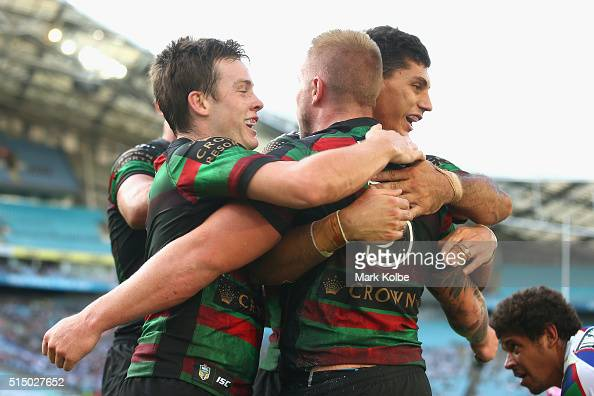 Luke Keary and Kyle Turner congratulate Aaron Gray of the Rabbitohs after he scored a try during the round two NRL match between the South Sydney...