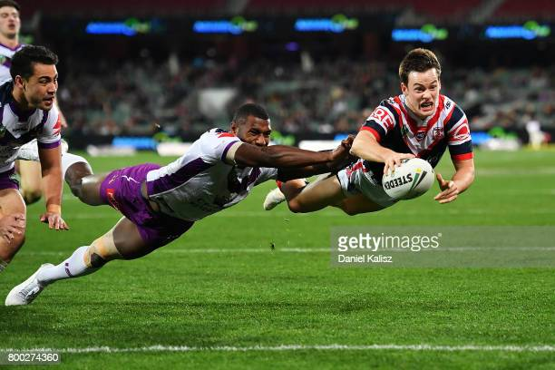 Luke Keary of the Roosters attempts a try during the round 16 NRL match between the Sydney Roosters and the Melbourne Storm at Adelaide Oval on June...