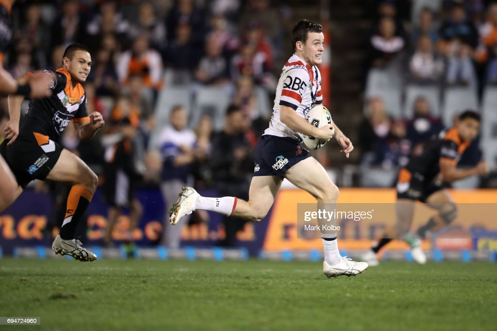 Luke Keary of the Roosters makes a break during the round 14 NRL match between between the Wests Tigers and the Sydney Roosters at Campbelltown Sports Stadium on June 11, 2017 in Sydney, Australia.