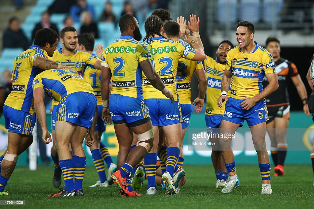 Luke Kelly of the Eels celebrates with his team mates after Semi Radradra of the Eels scored a try during the round 17 NRL match between the Wests Tigers and the Parramatta Eels at ANZ Stadium on July 6, 2015 in Sydney, Australia.