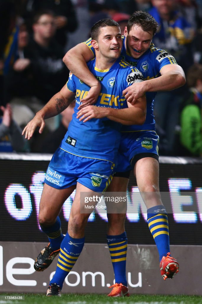 Luke Kelly of the Eels is congratulated by his team mate Ryan Morgan of the Eels after scoring a try during the round 18 NRL match between Parramatta Eels and the Penrith Panthers at Parramatta Stadium on July 13, 2013 in Sydney, Australia.