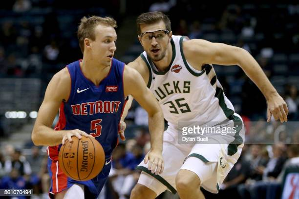 Luke Kennard of the Detroit Pistons dribbles the ball while being guarded by Mirza Teletovic of the Milwaukee Bucks in the fourth quarter during a...