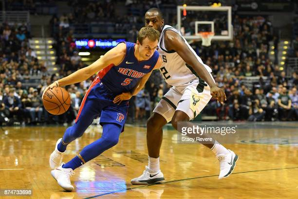Luke Kennard of the Detroit Pistons drives around Khris Middleton of the Milwaukee Bucks during the second half of a game at the Bradley Center on...