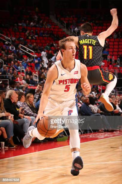 Luke Kennard of the Detroit Pistons handles the ball against the Atlanta Hawks on October 6 2017 at Little Caesars Arena in Detroit Michigan NOTE TO...