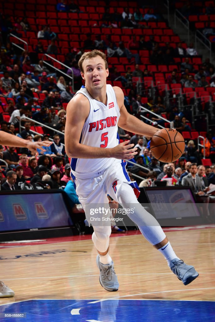 Luke Kennard #5 of the Detroit Pistons handles the ball against the Atlanta Hawks on October 6, 2017 at Little Caesars Arena in Detroit, Michigan.