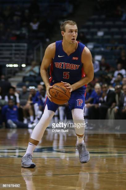 Luke Kennard of the Detroit Pistons handles the ball in the fourth quarter against the Milwaukee Bucks during a preseason game at BMO Harris Bradley...