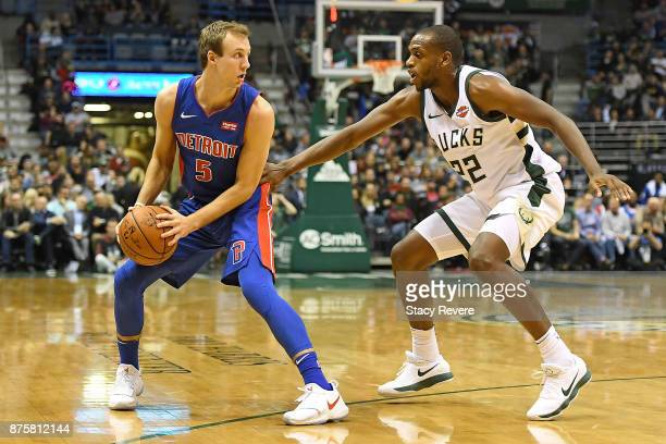 Luke Kennard of the Detroit Pistons is defended by Khris Middleton of the Milwaukee Bucks during a game at the Bradley Center on November 15 2017 in...