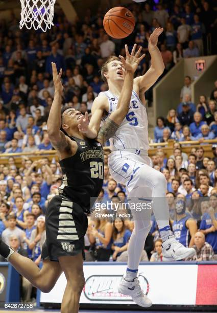 Luke Kennard of the Duke Blue Devils and John Collins of the Wake Forest Demon Deacons battle for a loose ball during their game at Cameron Indoor...