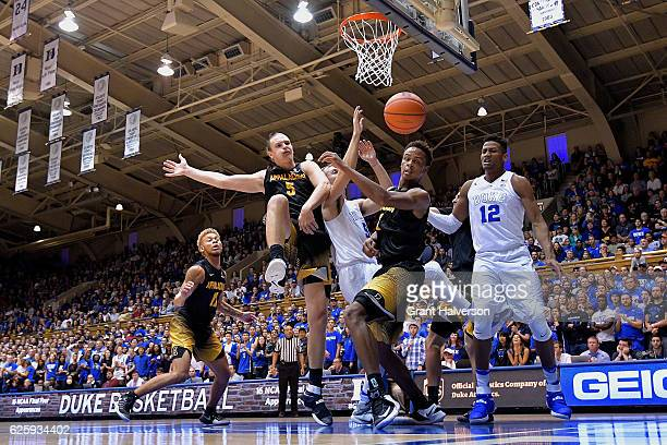 Luke Kennard of the Duke Blue Devils battles Griffin Kinney and Isaac Johnson of the Appalachian State Mountaineers for a rebound during the game at...