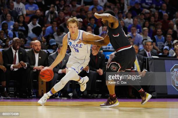 Luke Kennard of the Duke Blue Devils dribbles the ball against Sindarius Thornwell of the South Carolina Gamecocks in the first half during the...