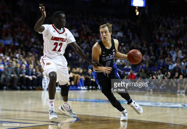 Luke Kennard of the Duke Blue Devils drives against Deng Adel of the Louisville Cardinals during the Quarterfinals of the ACC Basketball Tournament...