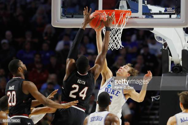 Luke Kennard of the Duke Blue Devils fouls Sedee Keita of the South Carolina Gamecocks in the first half during the second round of the 2017 NCAA...