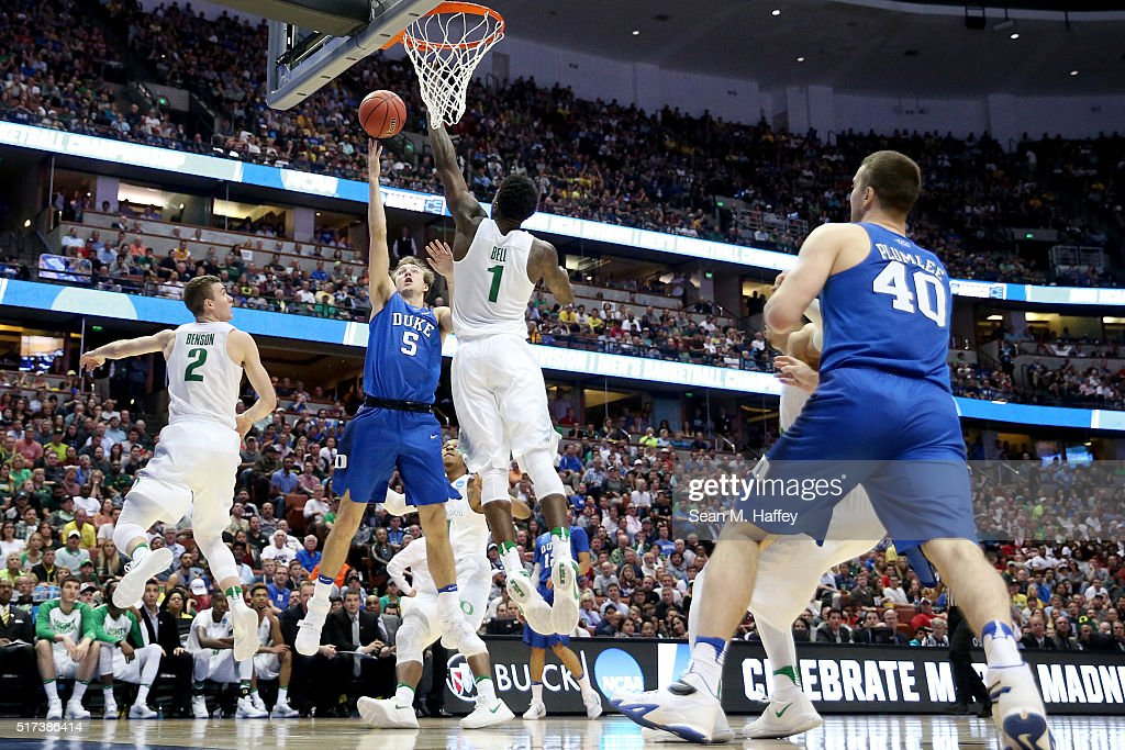 Luke Kennard of the Duke Blue Devils goes up for a shot over Jordan Bell of the Oregon Ducks in the second half in the 2016 NCAA Men's Basketball...