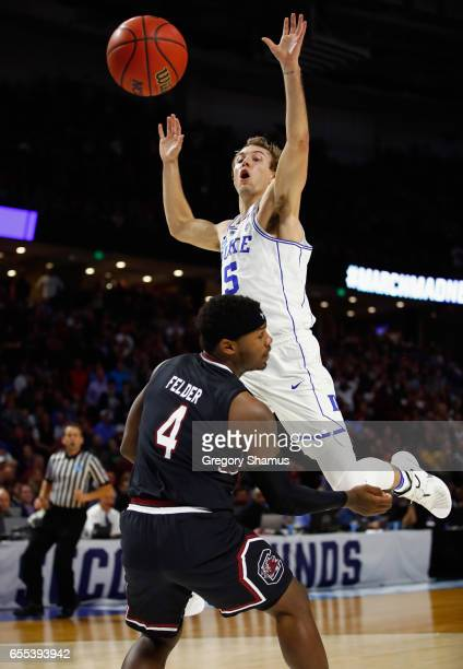 Luke Kennard of the Duke Blue Devils loses the ball against Rakym Felder of the South Carolina Gamecocks in the second half during the second round...