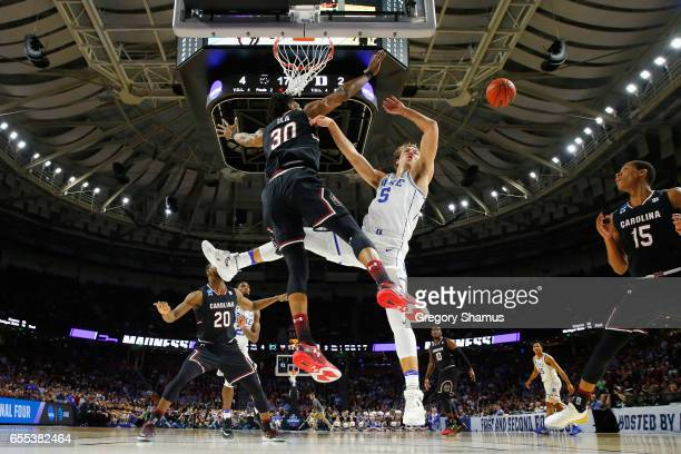 Luke Kennard of the Duke Blue Devils loses the ball as he drives to the basket against Chris Silva of the South Carolina Gamecocks in the first half...