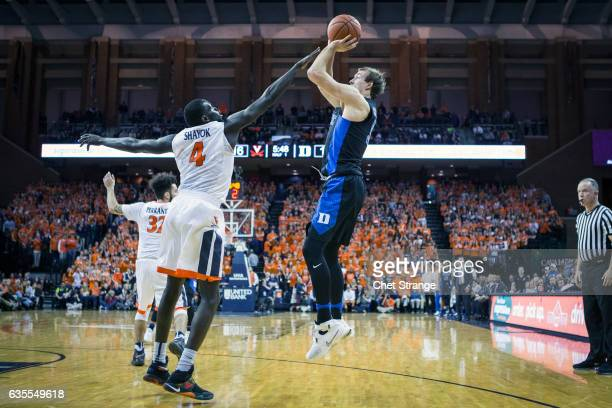 Luke Kennard of the Duke Blue Devils shoots a basket over Marial Shayok of the Virginia Cavaliers during a game at John Paul Jones Arena on February...