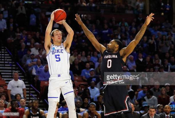 Luke Kennard of the Duke Blue Devils shoots the ball against Sindarius Thornwell of the South Carolina Gamecocks in the first half during the second...