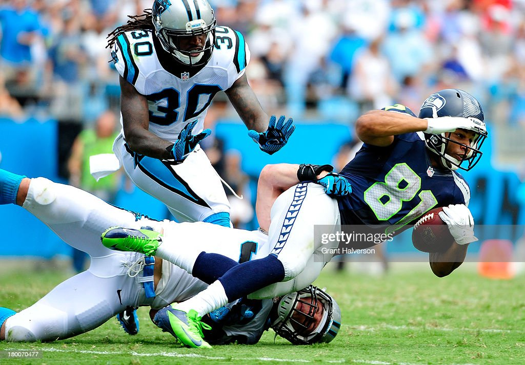 <a gi-track='captionPersonalityLinkClicked' href=/galleries/search?phrase=Luke+Kuechly&family=editorial&specificpeople=6234948 ng-click='$event.stopPropagation()'>Luke Kuechly</a> #59 of the Carolina Panthers brings down <a gi-track='captionPersonalityLinkClicked' href=/galleries/search?phrase=Golden+Tate&family=editorial&specificpeople=4500989 ng-click='$event.stopPropagation()'>Golden Tate</a> #81 of the Seattle Seahawks during play at Bank of America Stadium on September 8, 2013 in Charlotte, North Carolina. Seattle won 12-7.