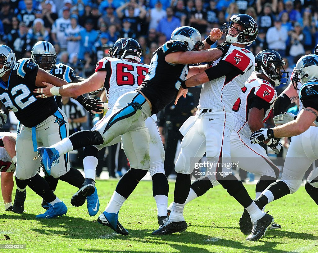 <a gi-track='captionPersonalityLinkClicked' href=/galleries/search?phrase=Luke+Kuechly&family=editorial&specificpeople=6234948 ng-click='$event.stopPropagation()'>Luke Kuechly</a> #59 of the Carolina Panthers hits <a gi-track='captionPersonalityLinkClicked' href=/galleries/search?phrase=Matt+Ryan+-+Football+americano&family=editorial&specificpeople=4951318 ng-click='$event.stopPropagation()'>Matt Ryan</a> #2 of the Atlanta Falcons at Bank Of America Stadium on December 13, 2015 in Charlotte, North Carolina.