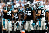 Luke Kuechly of the Carolina Panthers huddles with the defense during their game against the New Orleans Saints at Bank of America Stadium on...