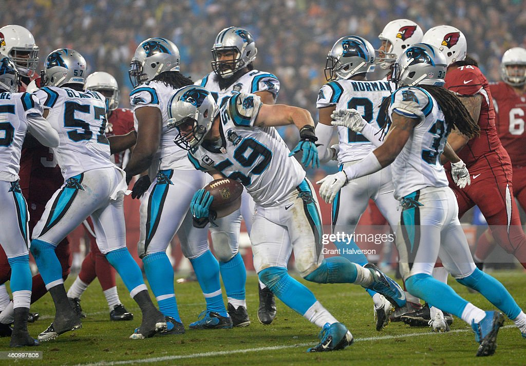 Luke Kuechly of the Carolina Panthers intercepts a pass against the Arizona Cardinals in the 4th quarter during their NFC Wild Card Playoff game at...