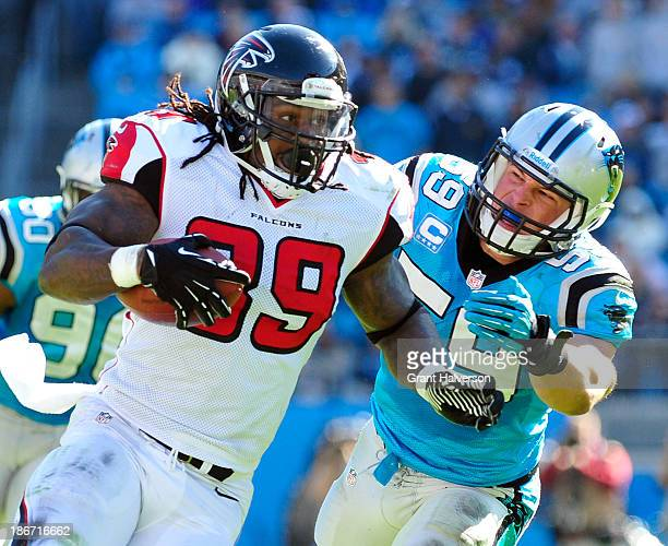 Luke Kuechly of the Carolina Panthers pursues Steven Jackson of the Atlanta Falcons during play at Bank of America Stadium on November 3 2013 in...