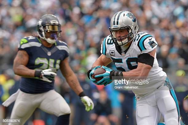 Luke Kuechly of the Carolina Panthers returns an interception for a touchdown during the first quarter of the NFC Divisional Playoff Game against the...
