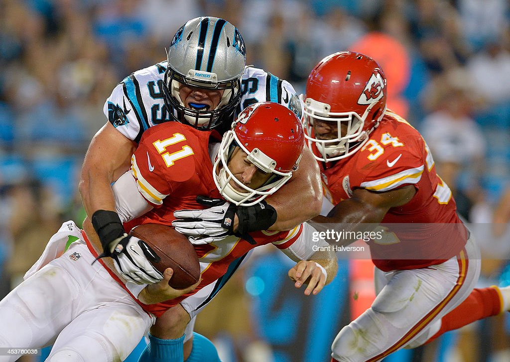Luke Kuechly #59 of the Carolina Panthers sacks Alex Smith #11 of the Kansas City Chiefs during their game at Bank of America Stadium on August 17, 2014 in Charlotte, North Carolina.