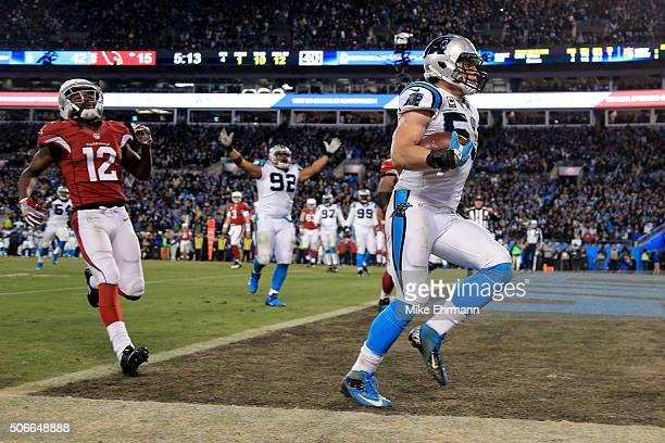 Luke Kuechly of the Carolina Panthers scores a touchdown after intercepting a pass in the fourth quarter against the Arizona Cardinals during the NFC...