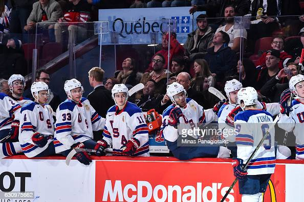 Luke Kunin of Team United States celebrates his goal with teammates on the bench during the 2017 IIHF World Junior Championship semifinal game...