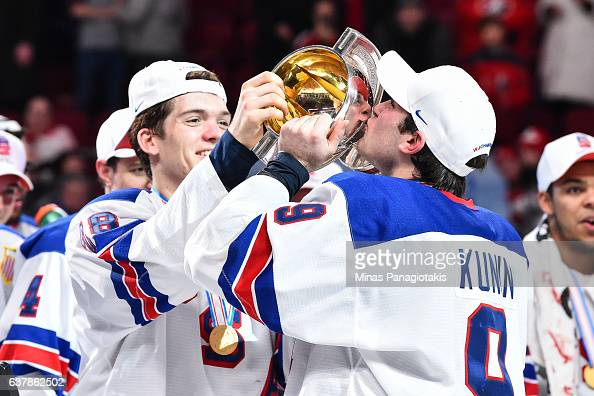 Luke Kunin of Team United States kisses the IIHF World Junior trophy during the 2017 IIHF World Junior Championship gold medal game against Team...
