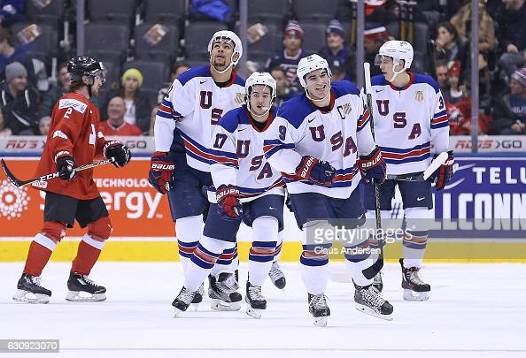 Luke Kunin of Team USA celebrates a goal against Team Switzerland during a QuarterFinal game at the 2017 IIHF World Junior Hockey Championships at...