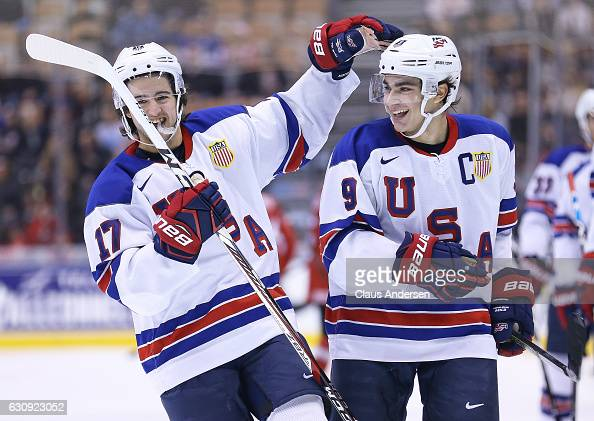 Luke Kunin of Team USA celebrates a goal with teammate Jeremy Bracco against Team Switzerland during a QuarterFinal game at the 2017 IIHF World...