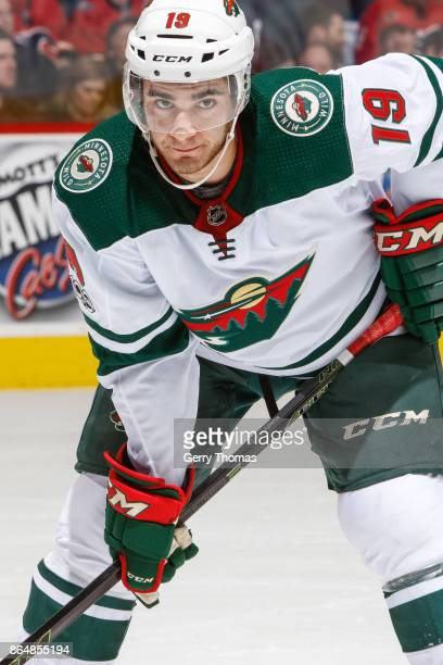 Luke Kunin of the Minnesota Wild at face off in an NHL game against the Minnesota Wild at the Scotiabank Saddledome on October 21 2017 in Calgary...