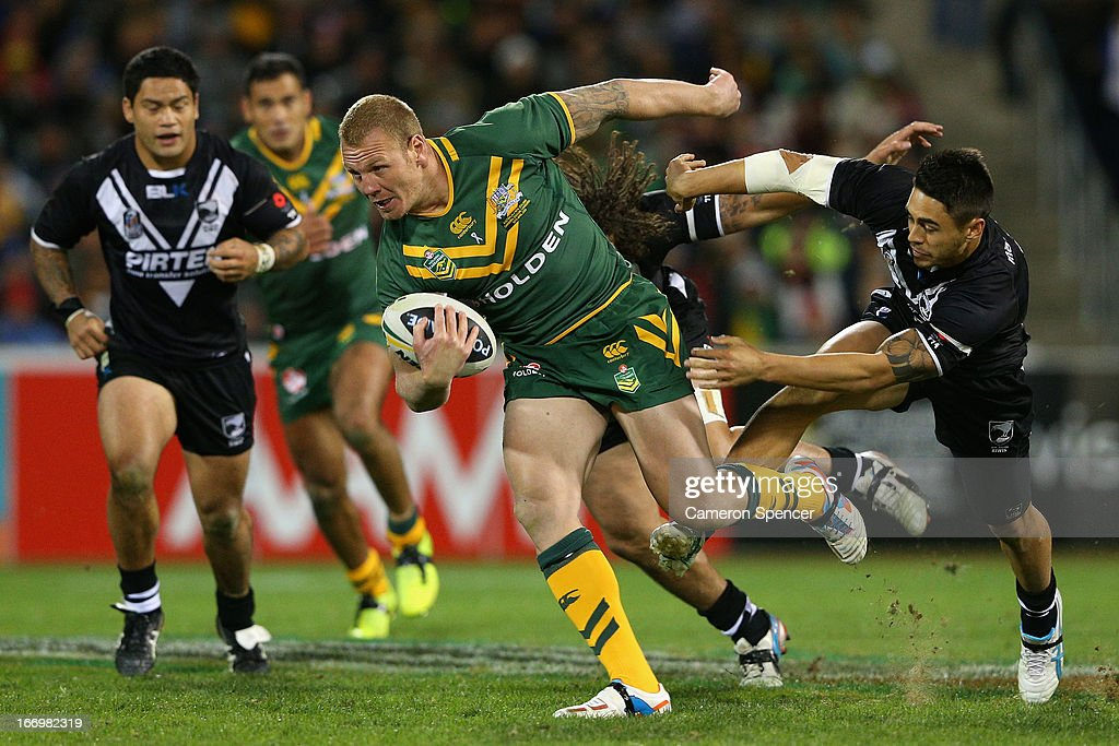 Luke Lewis of the Kangaroos makes a break during the ANZAC Test match between the Australian Kangaroos and the New Zealand Kiwis at Canberra Stadium on April 19, 2013 in Canberra, Australia.